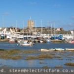 View looking north over the River Adur to Shoreham by Sea with the old footbridge still standing.